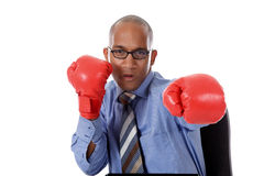 Young African American businessman, boxing gloves Stock Photos