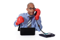 Young African American businessman, boxing gloves Royalty Free Stock Images