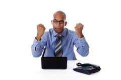 Young African American businessman, clenched fists Royalty Free Stock Photos