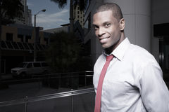 Young African American businessman smiling Royalty Free Stock Photos
