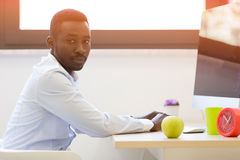Young african american businessman working on laptop computer Stock Photo