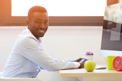 Young african american businessman working on laptop computer Royalty Free Stock Photography
