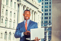 Young African American Businessman working in New York Royalty Free Stock Images
