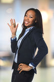 African American Businesswoman Holding Keys. Young African American businesswoman holding keys inside office building royalty free stock photos