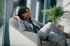Young african american businesswoman resting in chair and smiling Stock Image
