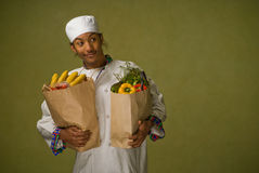 Young African American Chef Carrying Groceries Stock Images