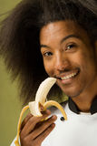 Young African American Chef Holding Banana Stock Photography
