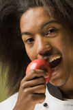 Young African American Chef Tasting Fruit Royalty Free Stock Image