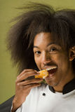 Young African American Chef Tasting Fruit Stock Photography