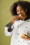 Young African American Chef Tasting Fruit Stock Photo