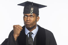 Young African American college graduate with tuition debt price tag, horizontal Royalty Free Stock Photography