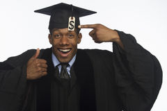 Young African American college graduate with tuition debt price tag, horizontal Stock Images