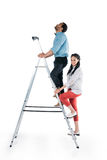 Young african american couple climbing on stepladder Royalty Free Stock Photos
