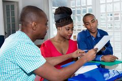 Young african american couple with contract of real estate agent. Indoor at new house royalty free stock photo