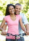 Young African American Couple Cycling In Park Stock Photos