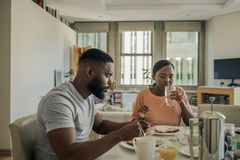 Free Young African American Couple Eating Breakfast Together In The Morning Stock Photography - 160626612