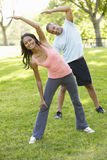 Young African American Couple Exercising In Park Royalty Free Stock Image