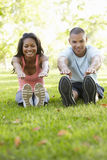 Young African American Couple Exercising In Park Stock Images