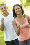 Young African American Couple Jogging In Park Royalty Free Stock Images