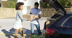 Young African American couple moving home Stock Image