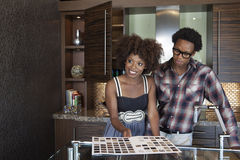 Young African American couple at new furnished kitchen stock image