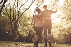 African American couple in park walking and having convers royalty free stock photos