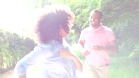 Young African American Couple Running Along Country Path Royalty Free Stock Photos