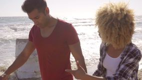 Young African American couple strolling on a beach stock footage
