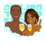 A young african american couple taking a bath with champagne Royalty Free Stock Image