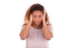 Young african american covering her ears with her hands isolated. On white background Royalty Free Stock Image