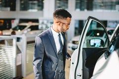 African american driver opening his new car door stock photos