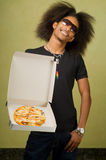 Young African American Enjoying a Pizza Stock Photo