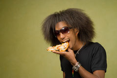 Young African American Enjoying a Pizza Royalty Free Stock Photo
