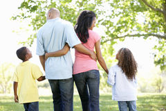 Young African American Family Enjoying Walk In Park Stock Photos