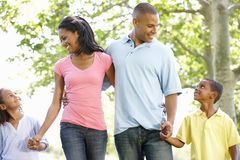 Young African American Family Enjoying Walk In Park Royalty Free Stock Images