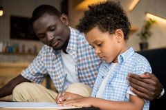 Father and son drawing together Stock Photo