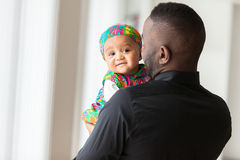 Young african american father holding with her baby girl Royalty Free Stock Photography