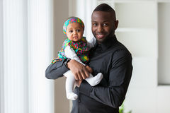 Young african american father holding with her baby girl. Young african american father holding with her cute baby girl stock image