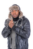 Young African-American feeling cold. Young African-American wearing winter clothing but feeling cold in a white background Royalty Free Stock Photos