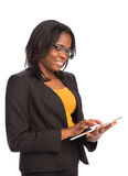 Young African American Female Holding a Touch Pad Tablet PC Royalty Free Stock Photo
