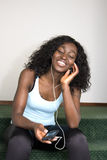 Young African American Female Listening to Music Stock Images