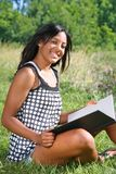 Young African American Female Reading Book Outdoor Royalty Free Stock Photos
