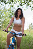 A Young African American Female Riding Bike  Outdoor Royalty Free Stock Photo