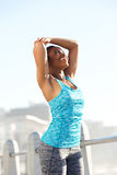 Young african american female runner stretching outside Royalty Free Stock Photo