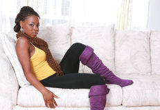 Young African American Female Sitting on Sofa Royalty Free Stock Photography
