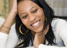 Young African American Female Smiling. While Laying Down Royalty Free Stock Images