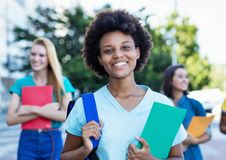 Young african american female student with group of women royalty free stock photography