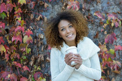 Young African American girl with afro hairstyle with coffee cup Stock Photos
