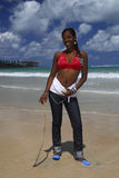 Young African American girl on Caribbean beach Royalty Free Stock Images