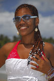Young African American girl on Caribbean beach. Young Afro Latin American girl in sunglasses on Caribbean beach, Dominican Republic, Caribbean, Americas Stock Image